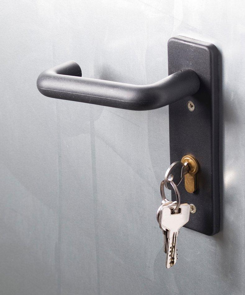 metal door with lock and keys - cybersecurity